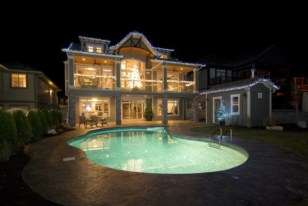Lighting for your Kelowna pool construction is perfect for a night time dip.